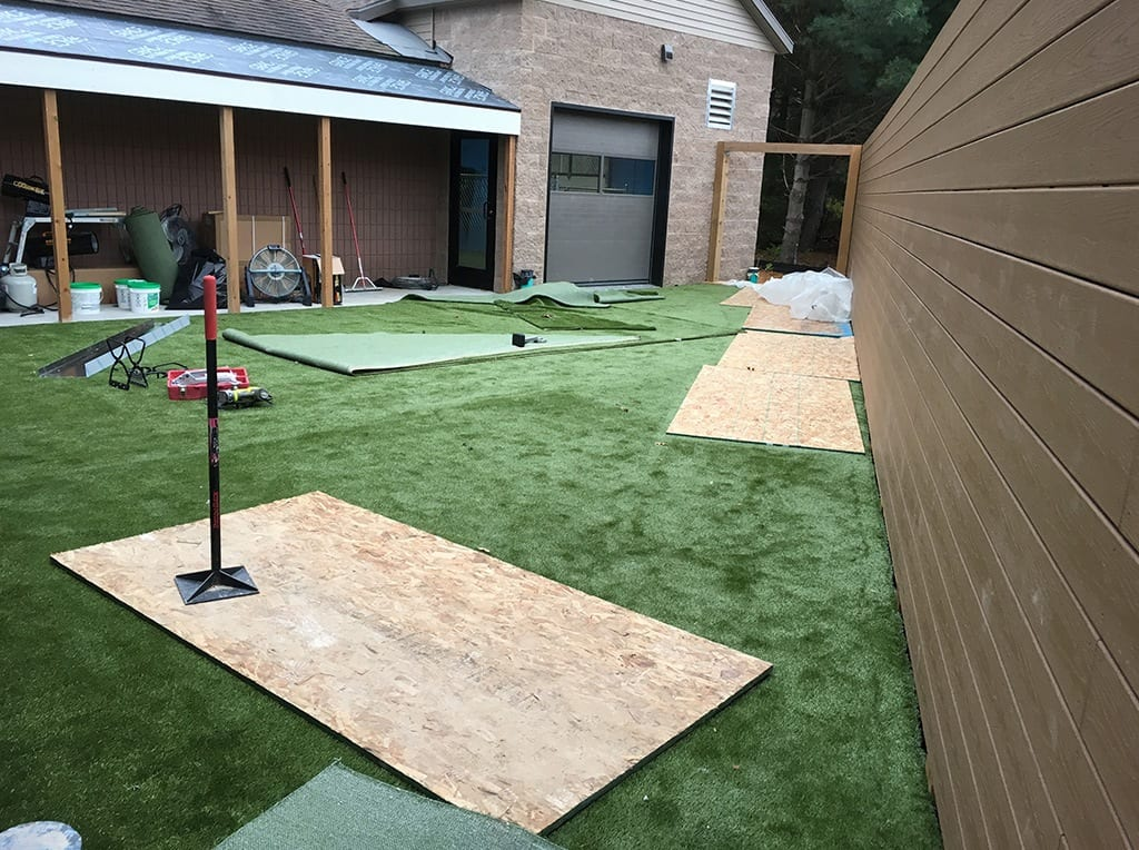 K9Grass by ForeverLawn being installed outside at Cascade Veterinary