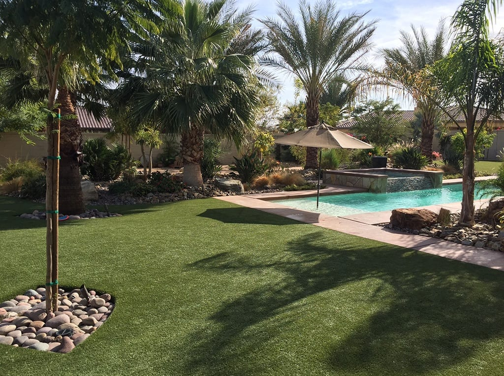 Poolside residential backyard with K9Grass installed by ForeverLawn Pacific Coast