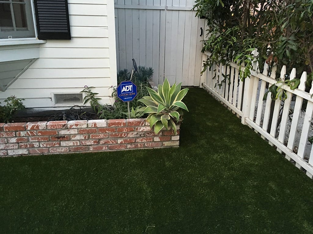 K9Grass by ForeverLawn landscaped around garden in residential front yard