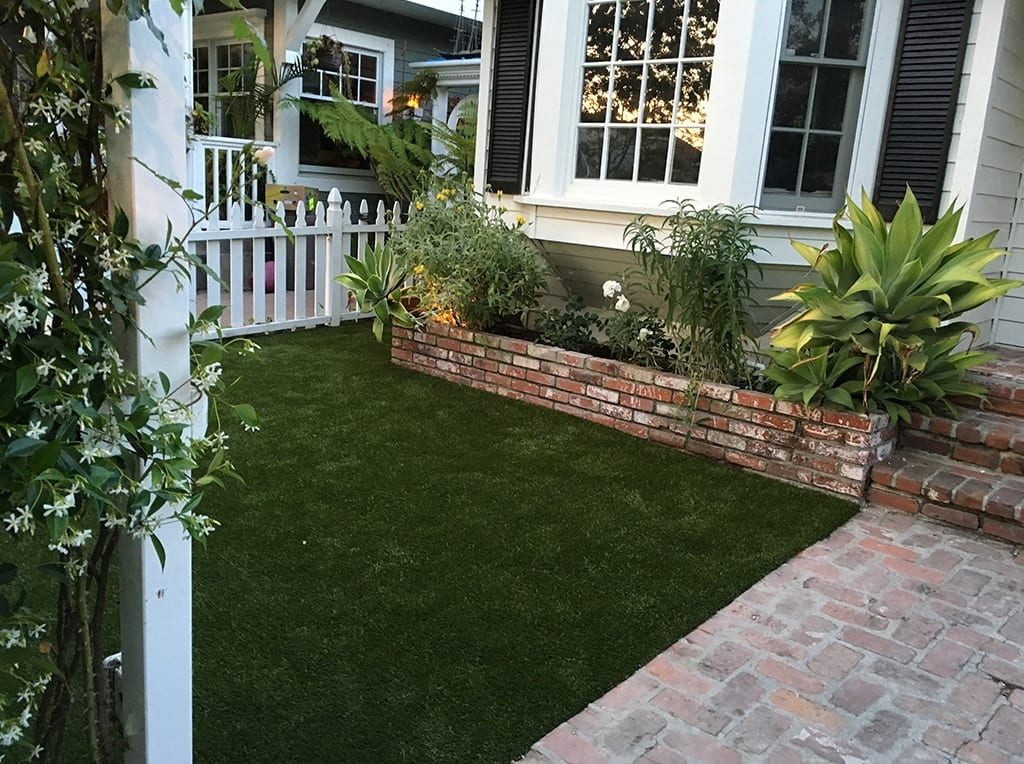 K9Grass installed in residential front yard around brick walkway