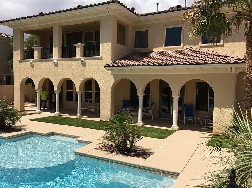 Backyard view of Las Vegas home with a pool and K9Grass installed by ForeverLawn Southwest