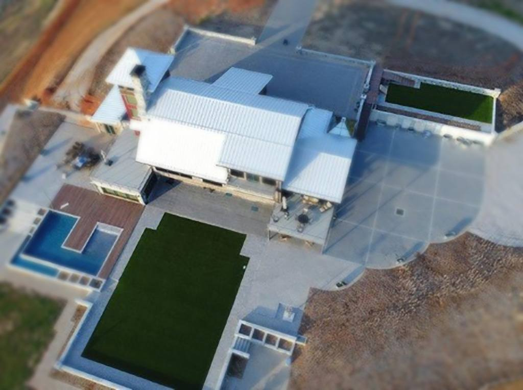 Aerial view of a South Carolina residence with K9Grass by ForeverLawn installed