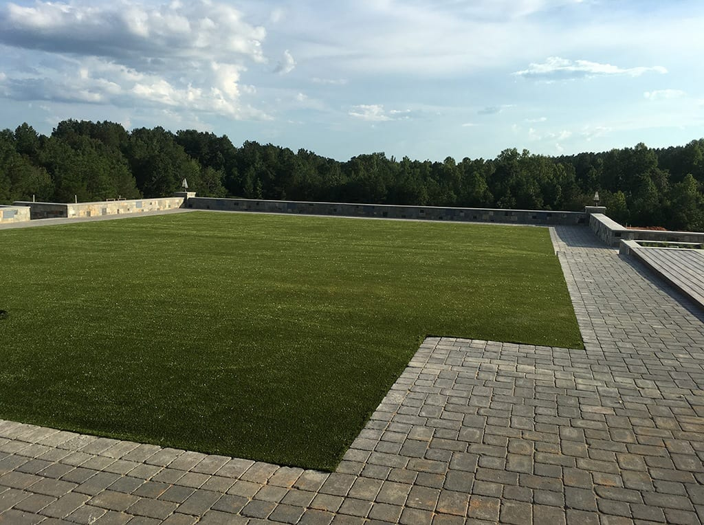 View of open backyard with K9Grass by ForeverLawn installed