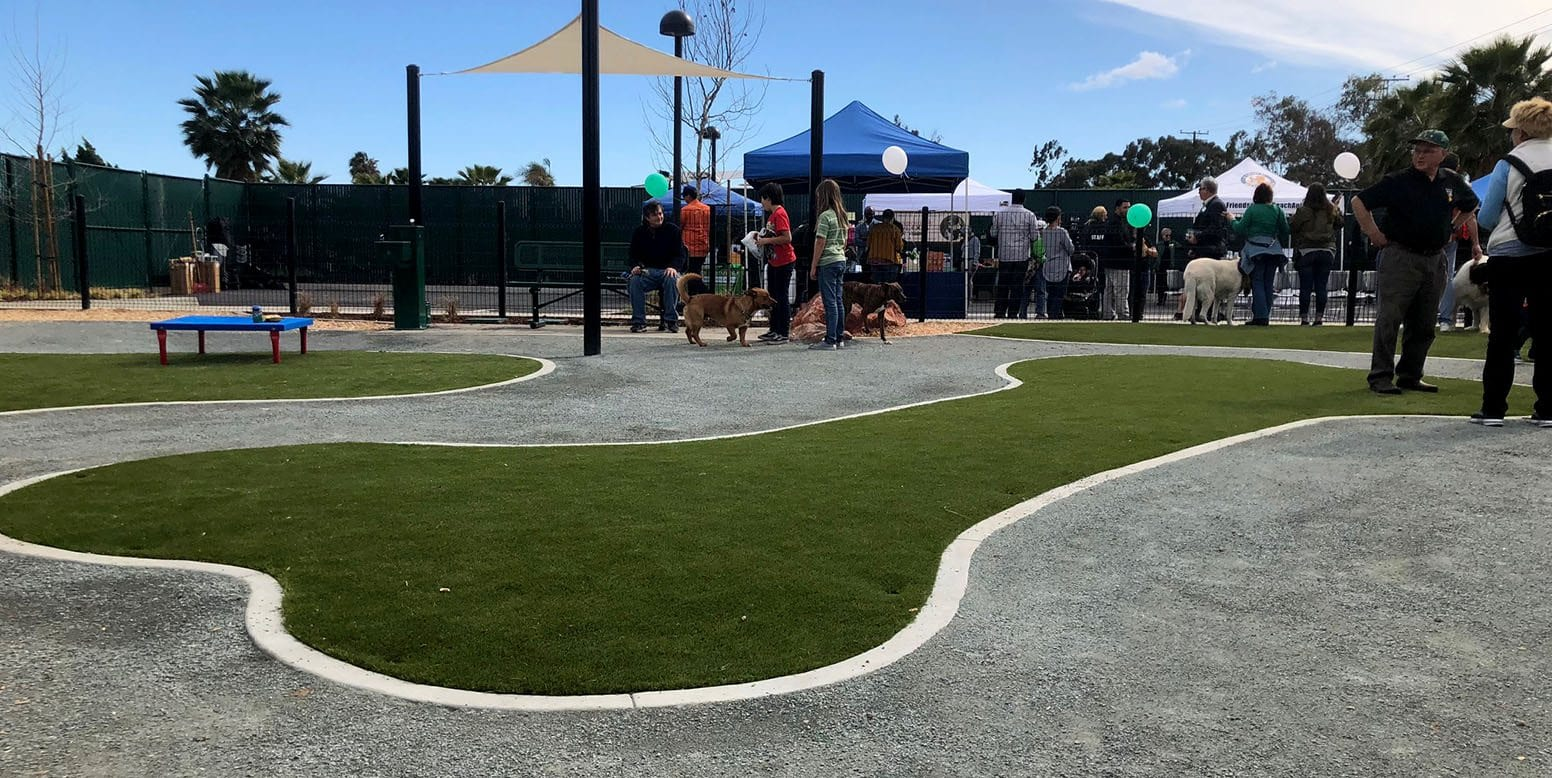 K9Grass artificial turf dog bone landscaping at Signal Hill Dog Park ribbon cutting ceremony in Long Beach, California