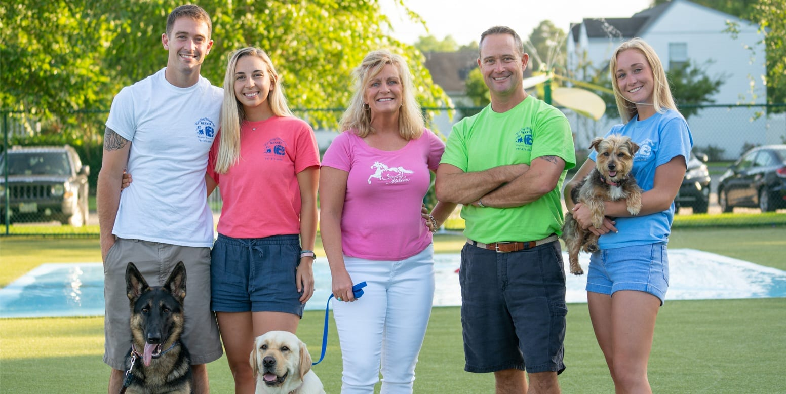 Sterling Meadows Kennel and Cattery owners and family standing on new K9Grass® Classic by ForeverLawn