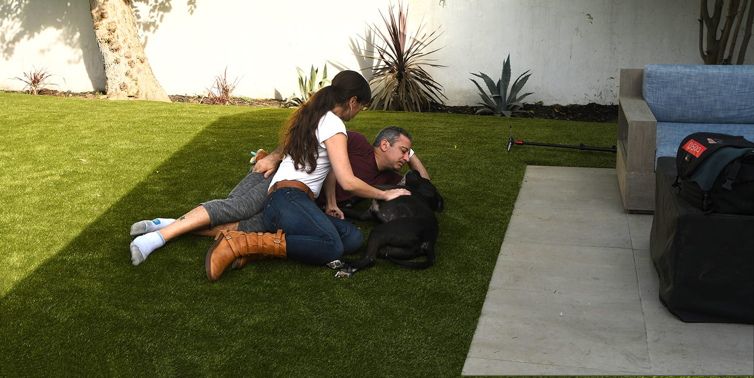Brian and Danielle Samuels and dog on K9Grass synthetic turf residential backyard in Sherman Oaks, CA