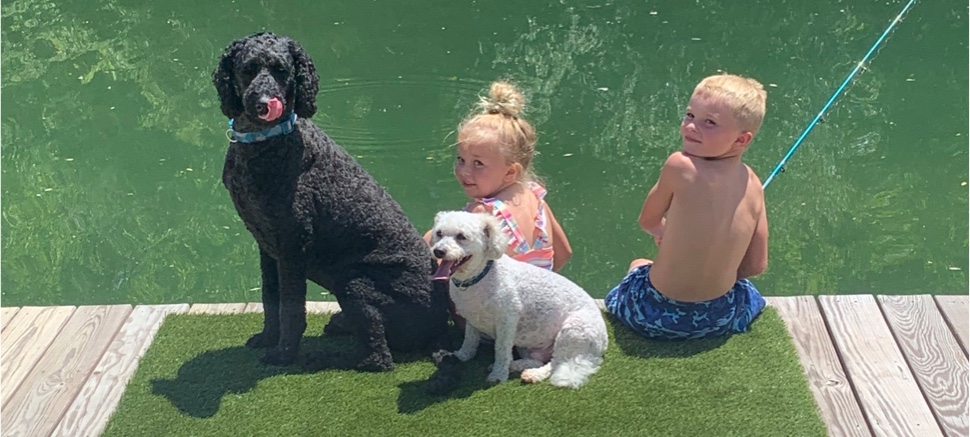 dog and kids fishing